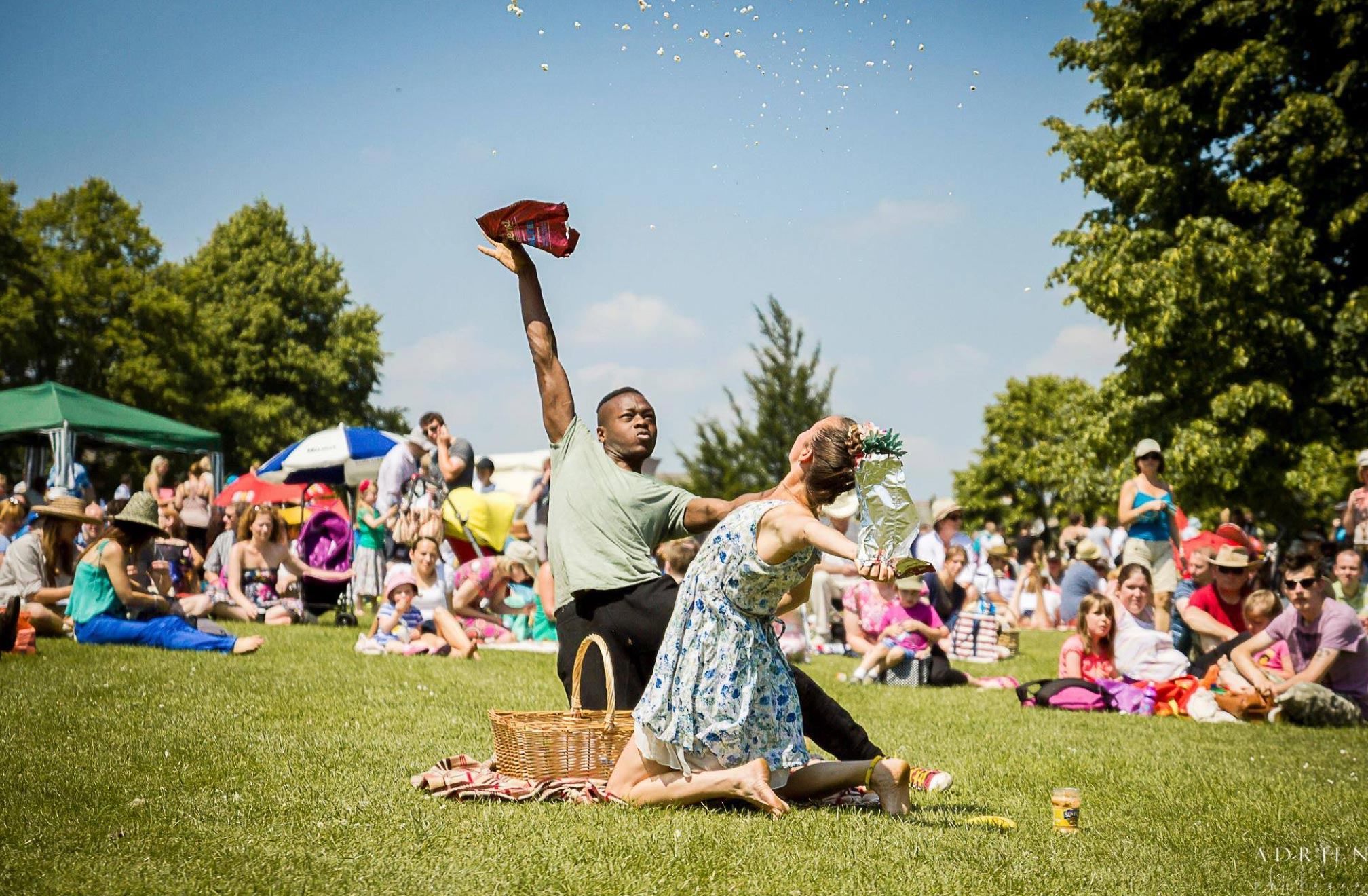 Two performers dancing at a picnic