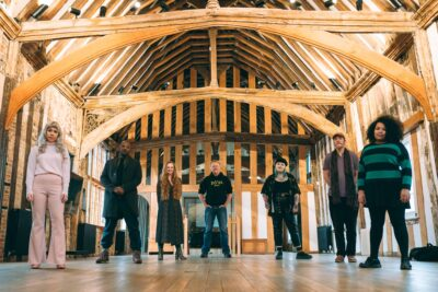 group of writers and performers in a barn