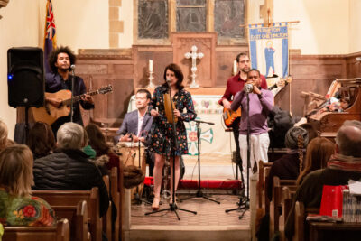 Band performing in a church with audience