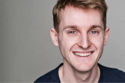 Man smiling, light brown short hair