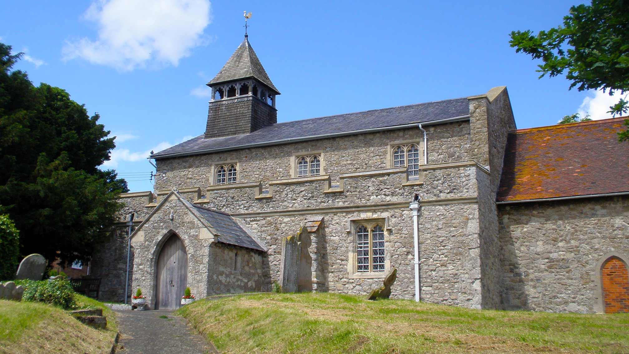 A stone built church on a summer day