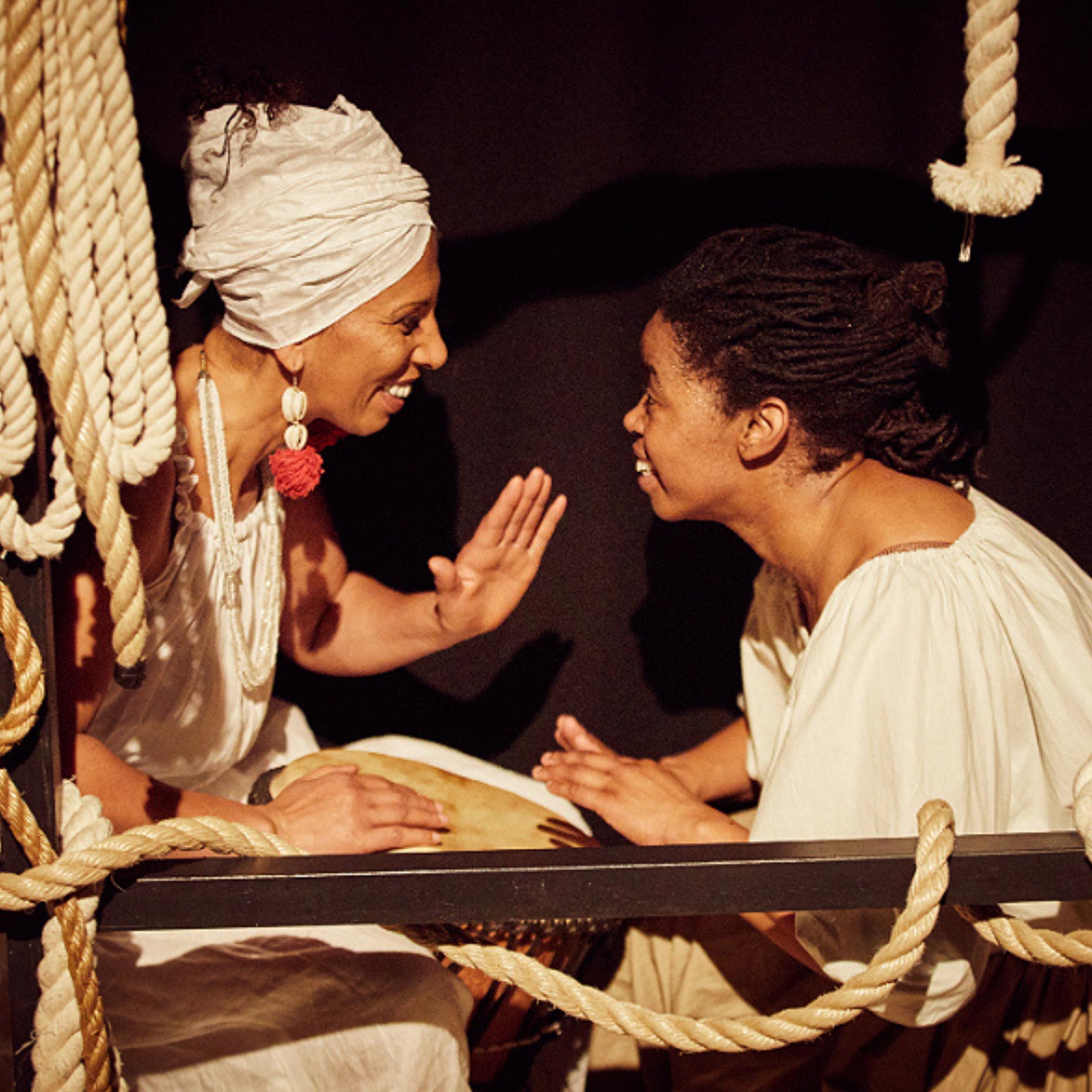 Two black ladies laughing